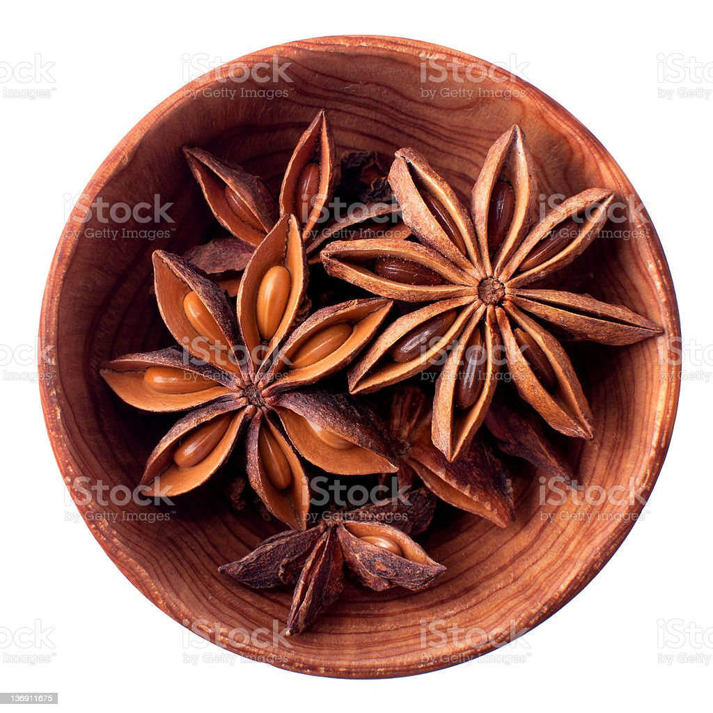 Anise stars in a wooden bowl isolated royalty-free stock photo