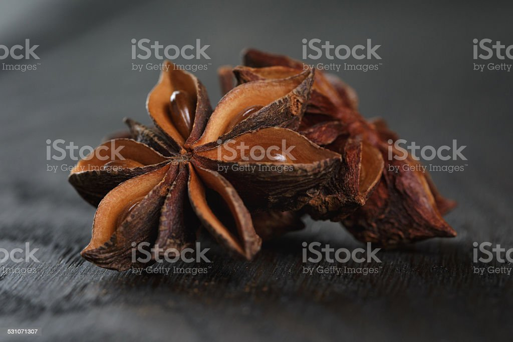 anise stars on old oak table stock photo