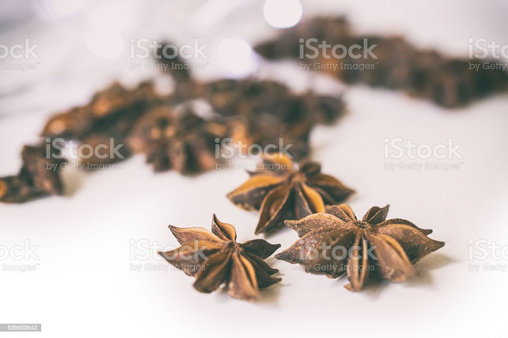 Anise stars on white table with copy space part III stock photo