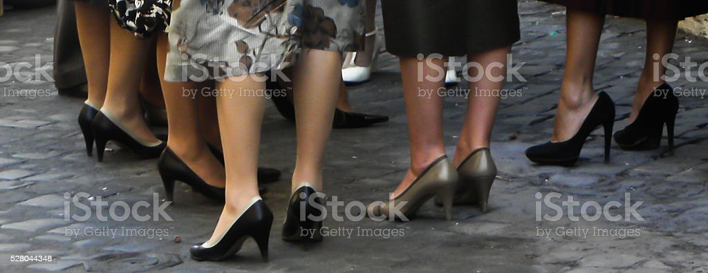 ankles and shoes of woman stock photo