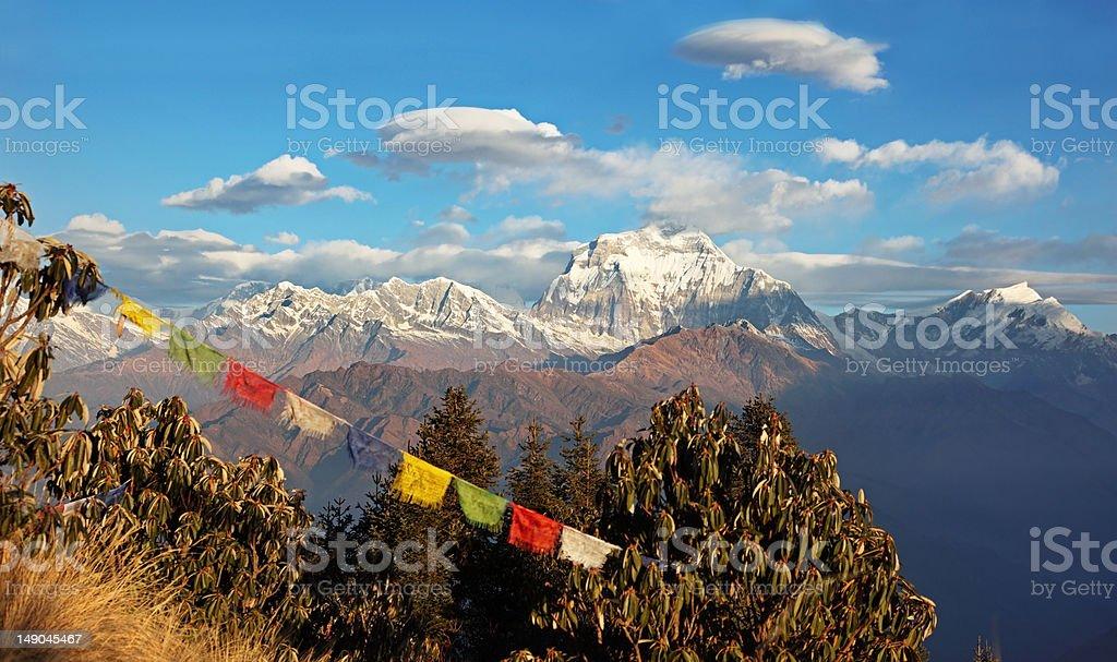 Annapurna mountains and Tibetan prayer flags royalty-free stock photo