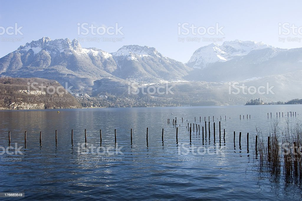 Annecy lake and snowed mountains stock photo