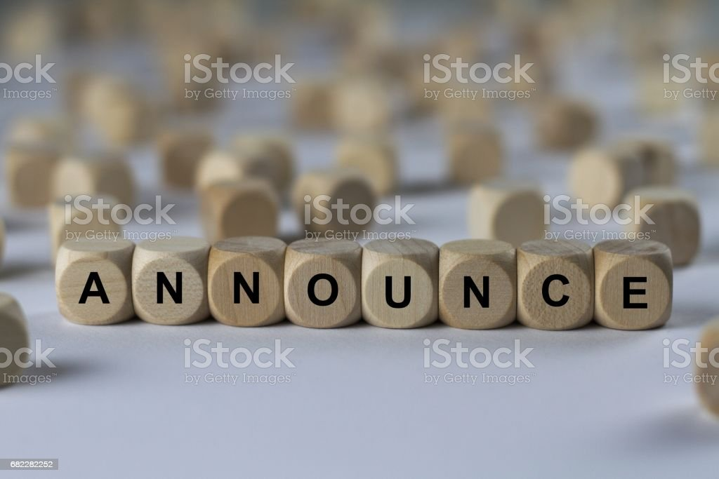 announce - cube with letters, sign with wooden cubes stock photo