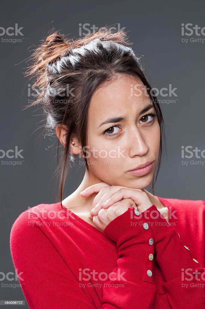 annoyed 20s brunette expressing sorrow and frustration stock photo