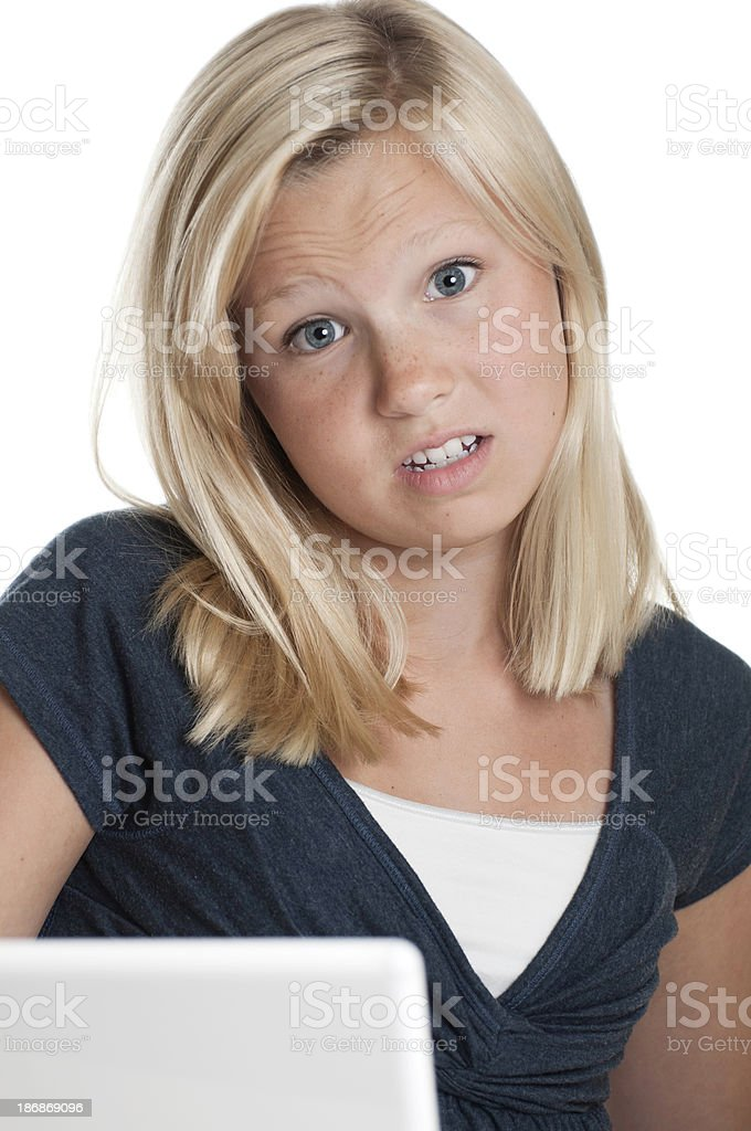 Annoyed Blond Teen at the Computer stock photo