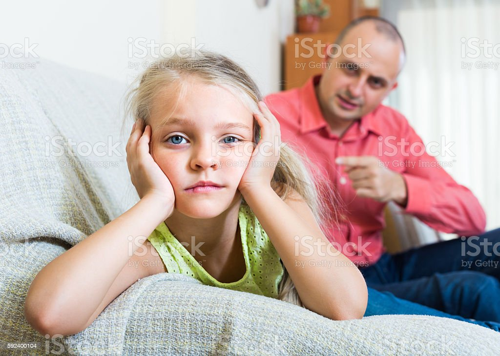 Annoyed father and frustrated daughter stock photo