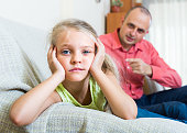 Annoyed father and frustrated daughter