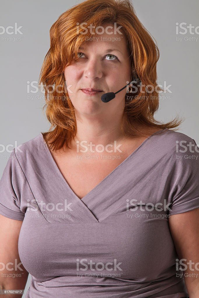 Annoyed receptionist stock photo