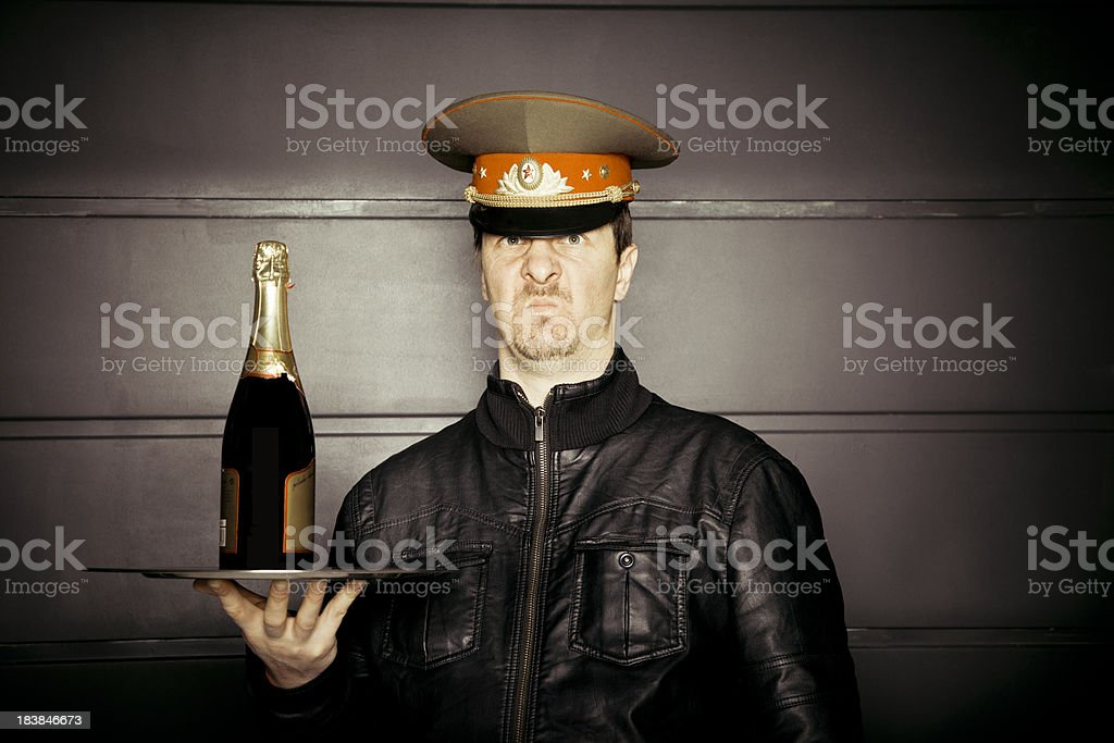 Annoyed soldier with serving the drinks stock photo