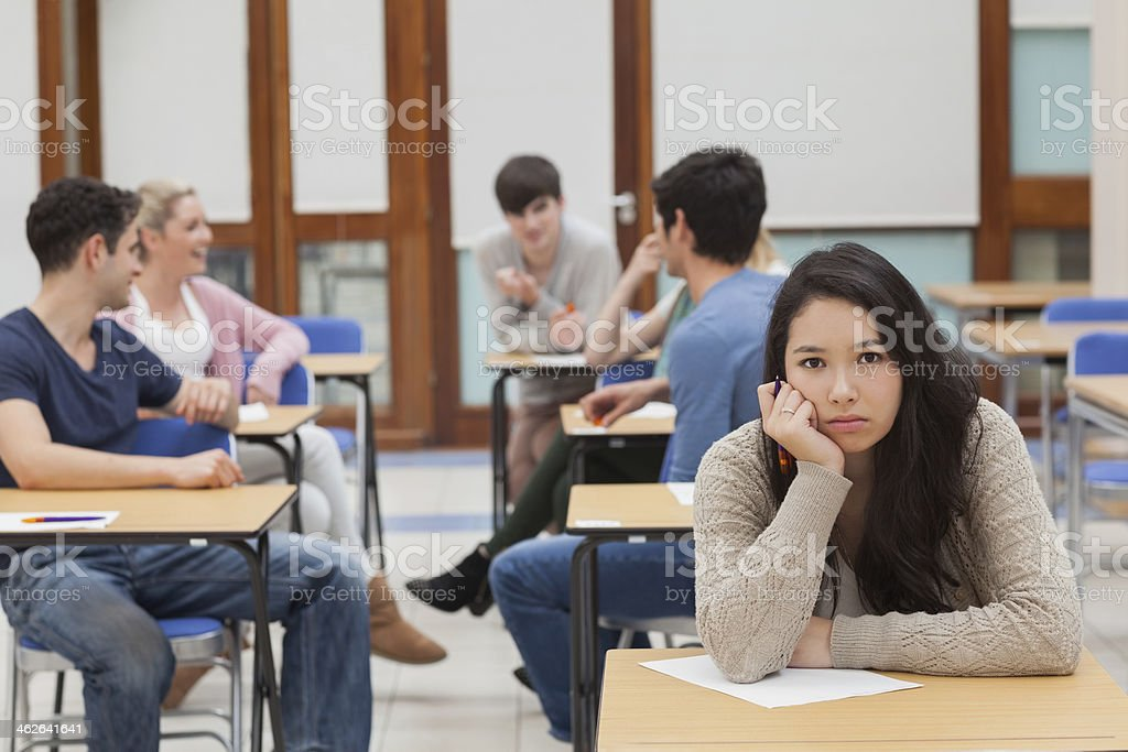 Annoyed student in a classroom stock photo