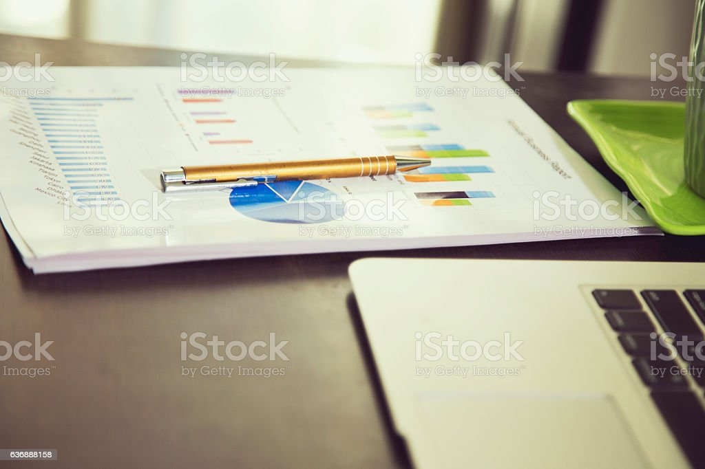 Annual business reports at office desk stock photo