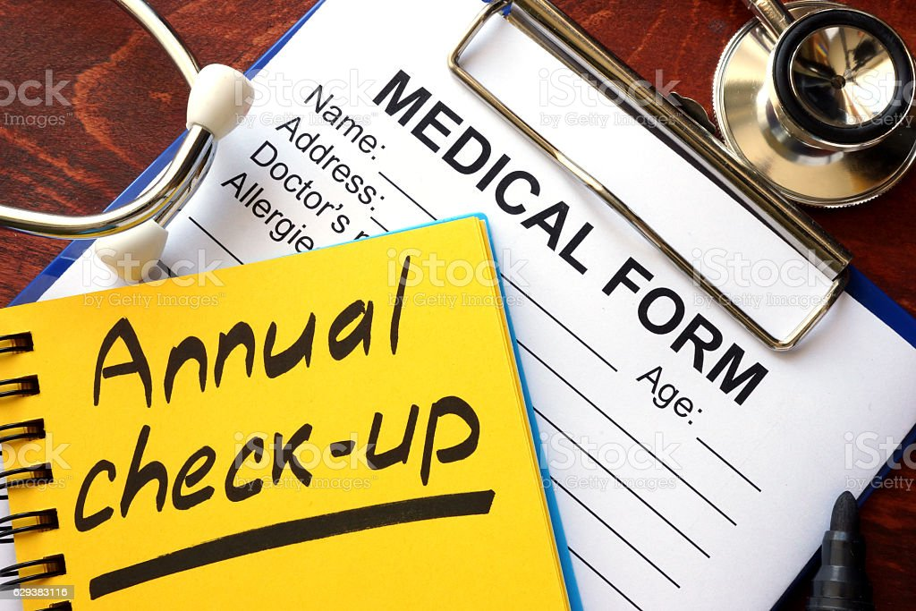 Annual check-up in a note and medical form. stock photo