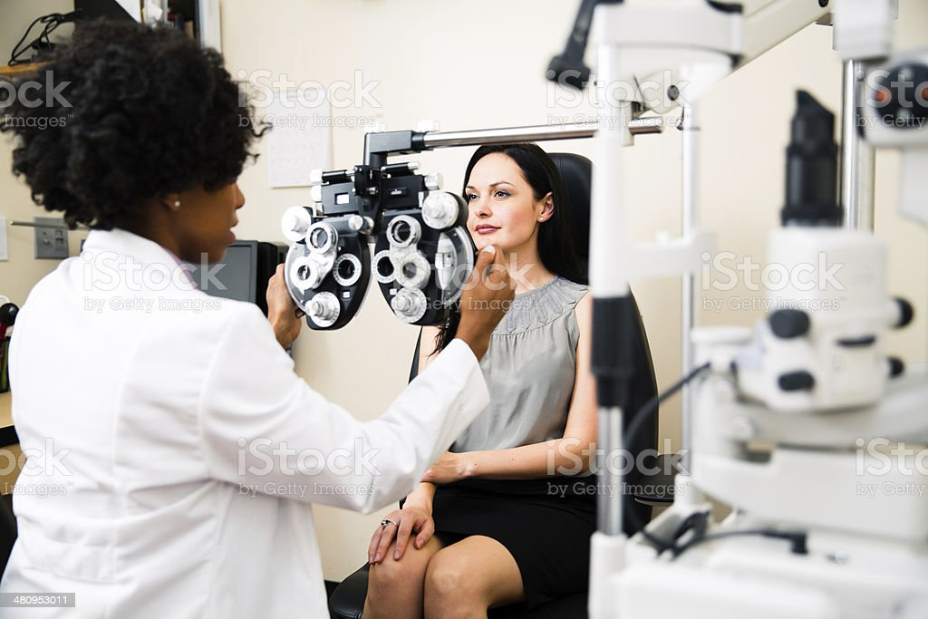 Annual eye exam by optometrist stock photo
