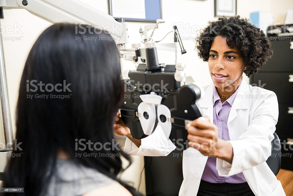 Annual eye exam by the optometrist stock photo