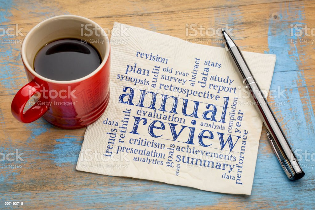 annual review word cloud on napkin stock photo