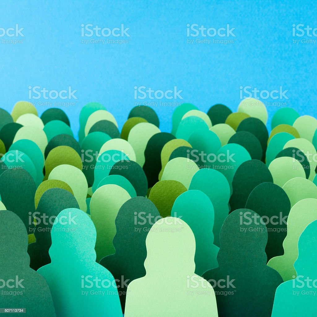 Anonymous green women crowd stock photo