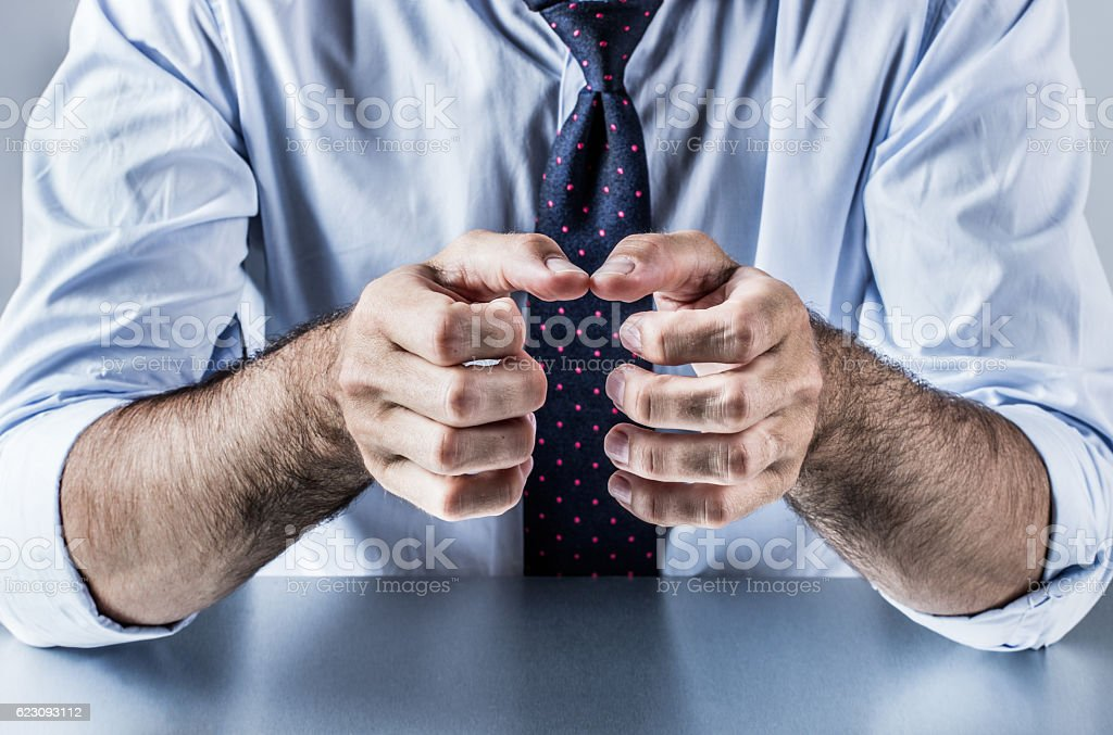 anonymous hands of businessman showing, explaining, presenting or grasping something stock photo