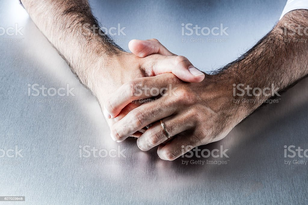 anonymous male arms showing symbol of engagement and wedding ring stock photo
