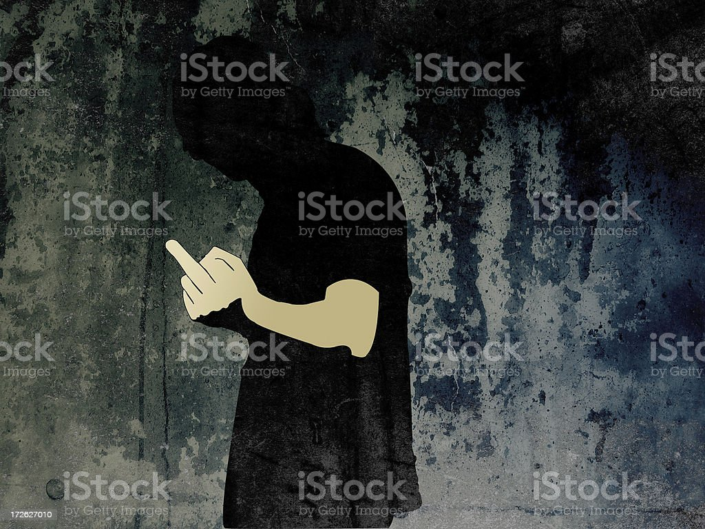 Anonymous man giving the finger with grunge wall in background stock photo