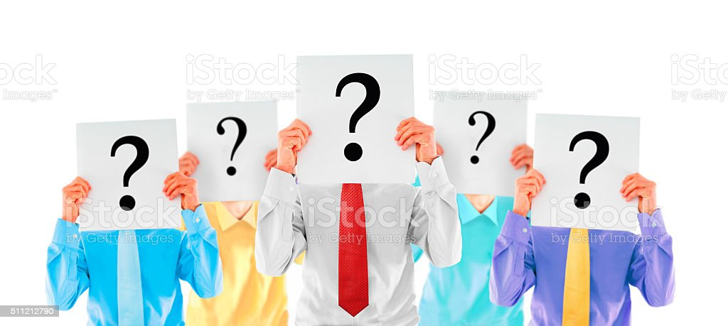 Anonymous people holding question mark stock photo