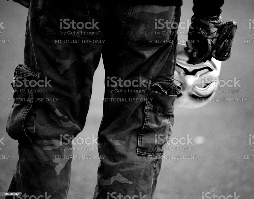 Anonymous Protester Lowers Guy Fawkes Mask royalty-free stock photo