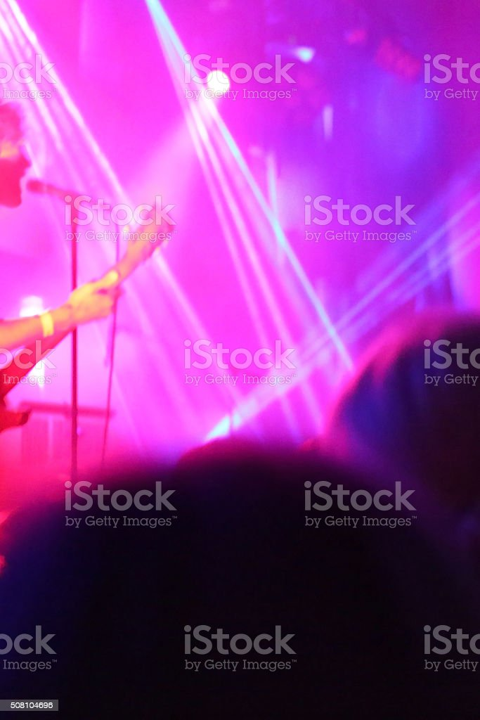 Anonymous singer silhouette on stage stock photo