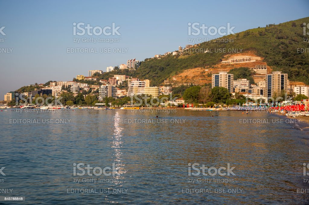 anorama of the city of Budva in the rays of the rising sun. stock photo