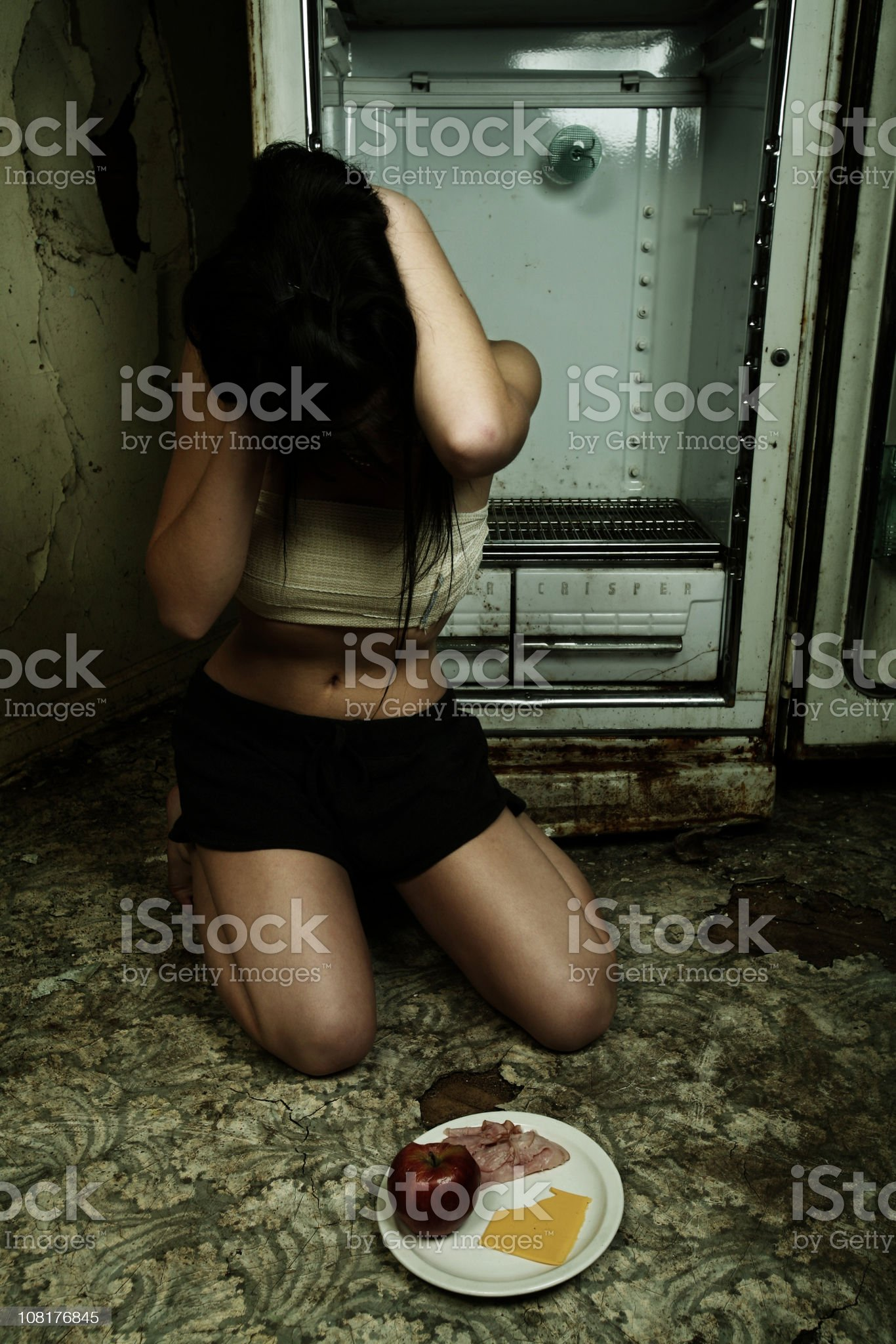 Anorexic Girl in Grungy Kitchen royalty-free stock photo