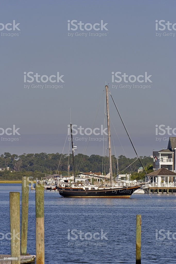 anquored private sailboat stock photo