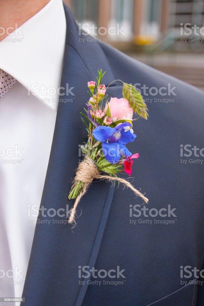 Ansteckblume am Anzug stock photo