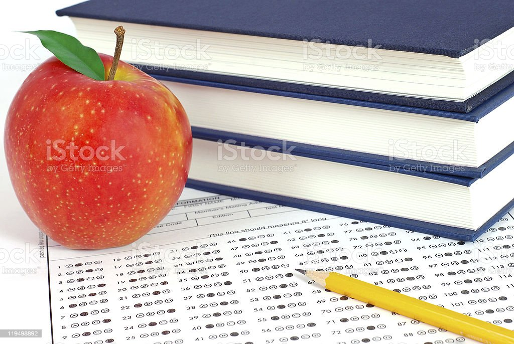 Answer sheet with pencil, books and apple royalty-free stock photo