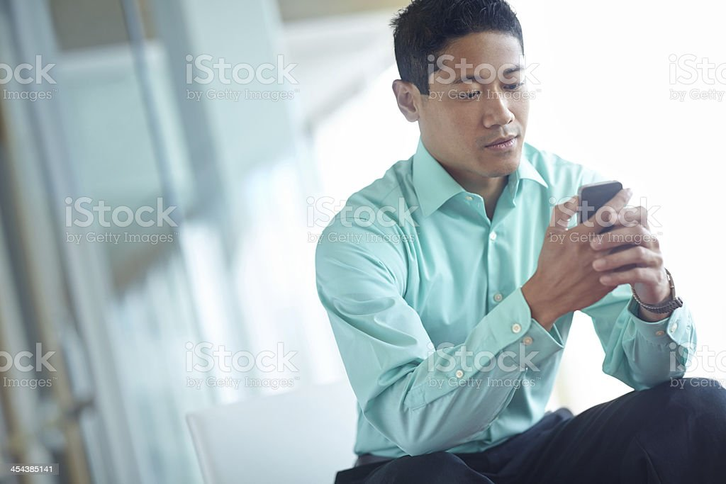 Answering a business text royalty-free stock photo
