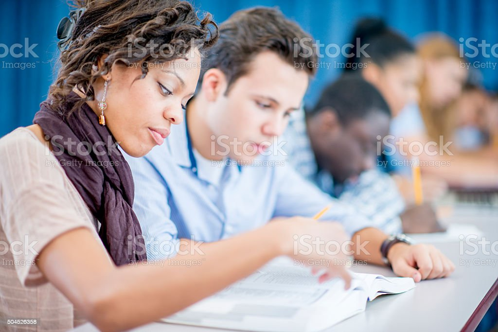 Answering a Question from a Textbook stock photo