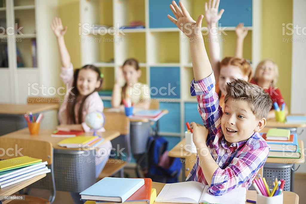 Answering at lesson stock photo