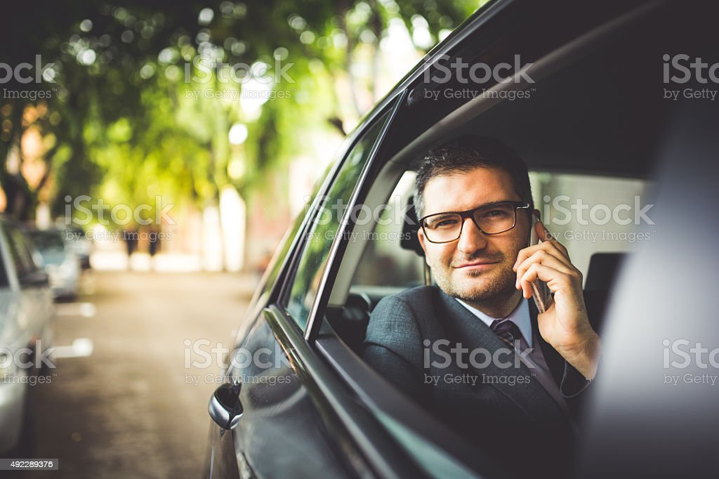 Answering Call in Car stock photo