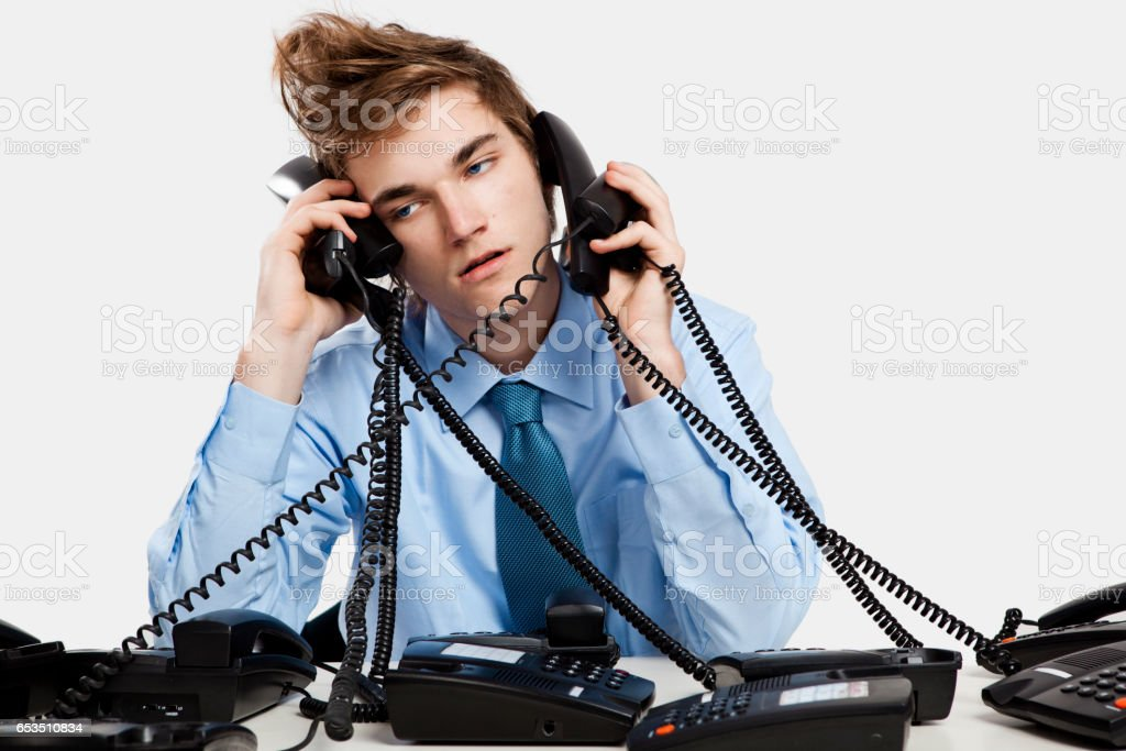 Answering calls stock photo