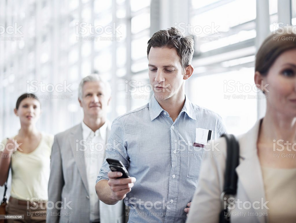 Answering one last call before boarding stock photo