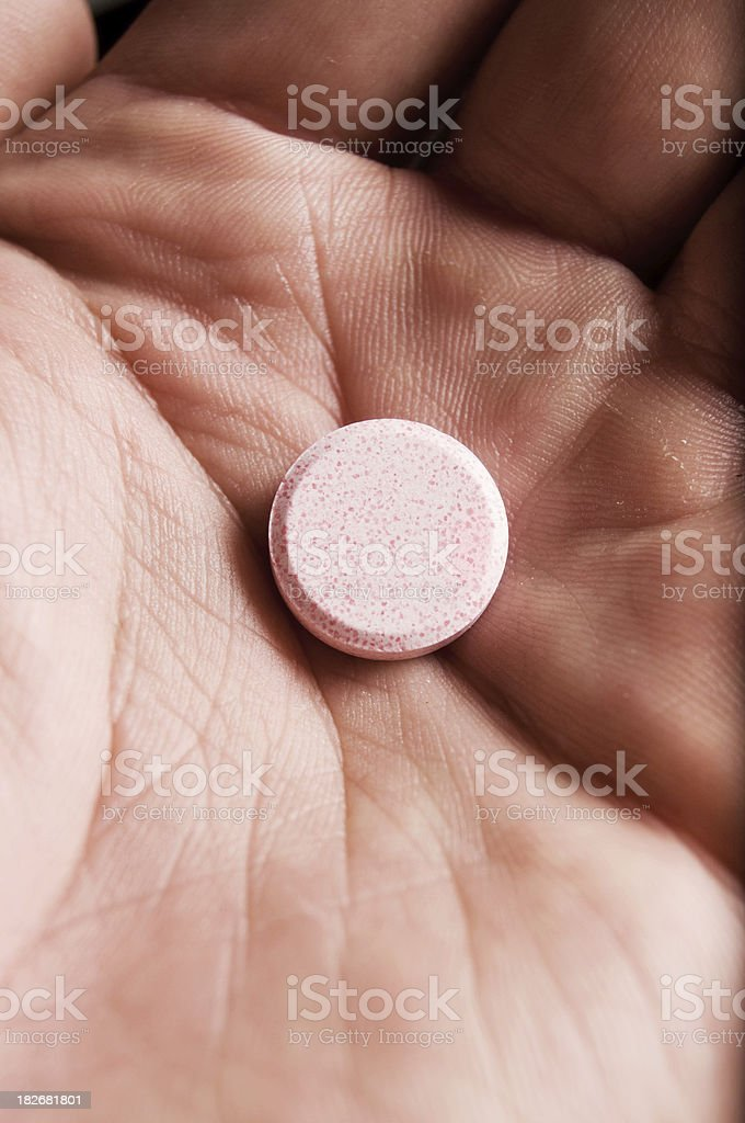Antacid Chewable Hand Vertical stock photo