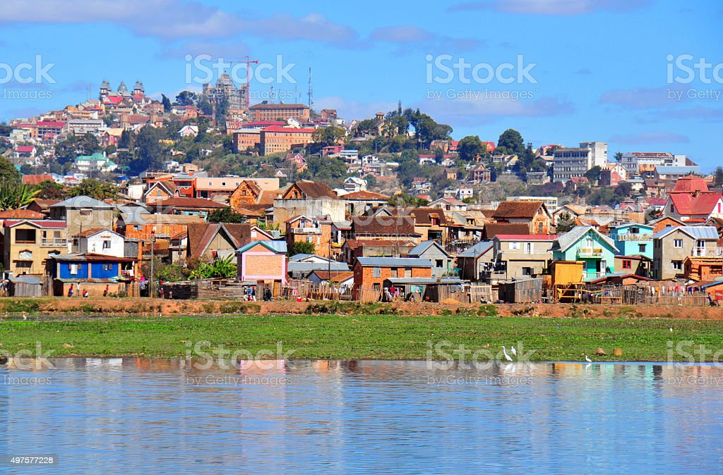 Antananarivo, Madagascar: Lake Masay, shanty town and palaces stock photo