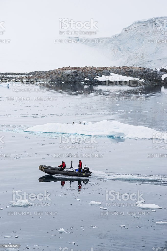 Antarctic Explorers Riding in Inflatable Zodiac Boat, Antarctica royalty-free stock photo
