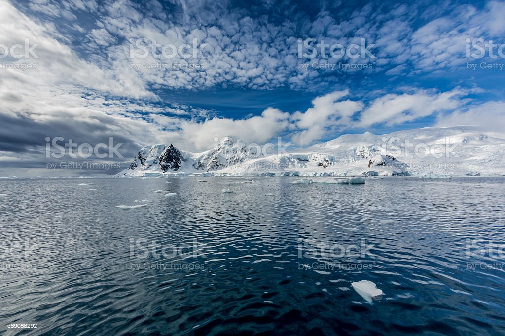 Antarctic peninsula covered in fresh snow stock photo