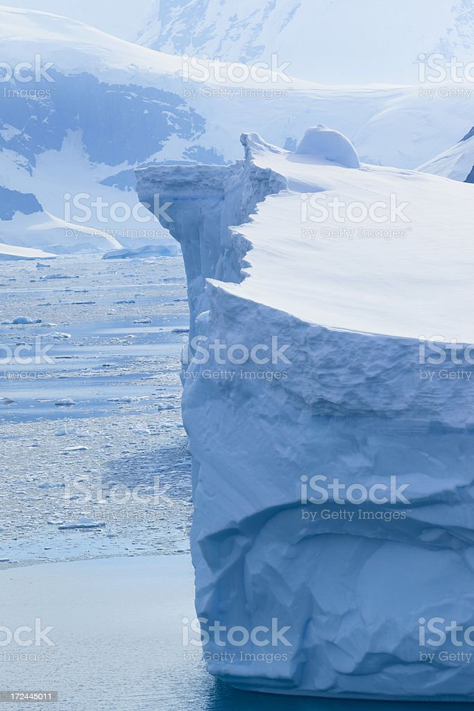 Antarctica blue iceberg floating stock photo