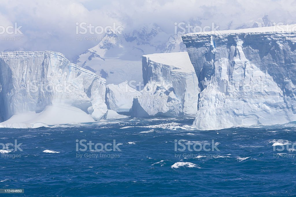 Antarctica iceberg floating at coastline stock photo