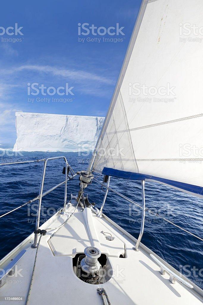 Antarctica sailing ship and iceberg royalty-free stock photo