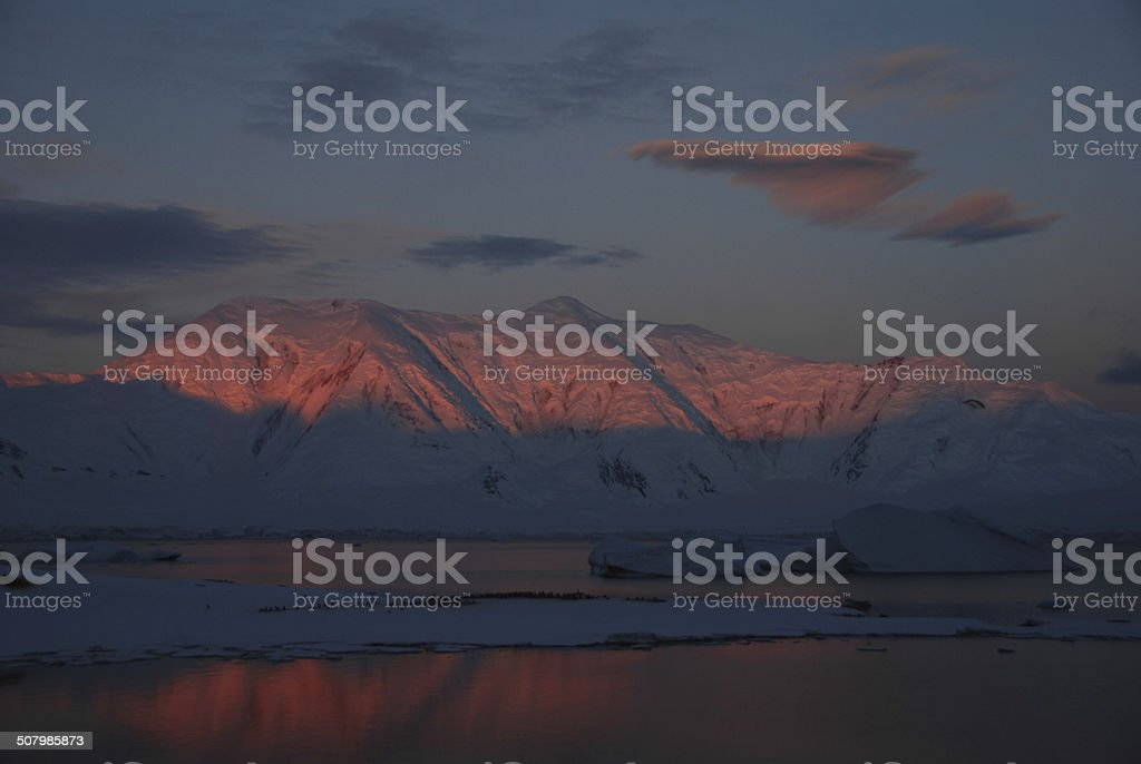 Antarctica. The red rays of the midnight sun stock photo