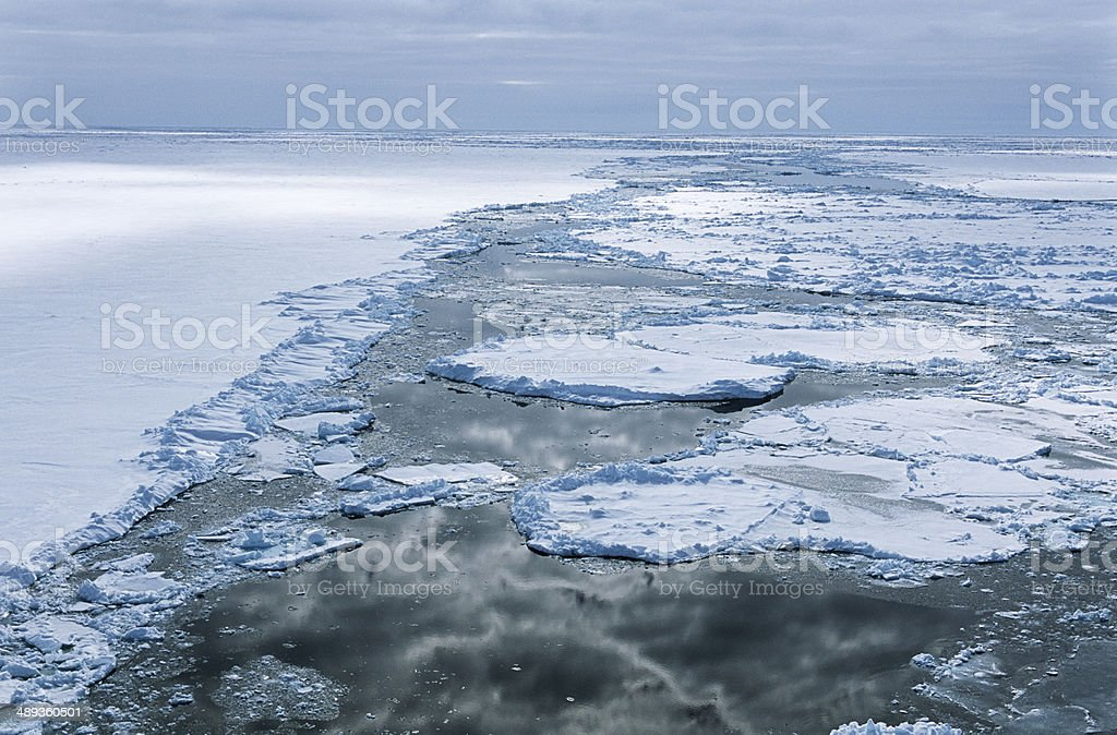 Antarctica, Weddell Sea, Ice floe, clouds reflecting in water stock photo