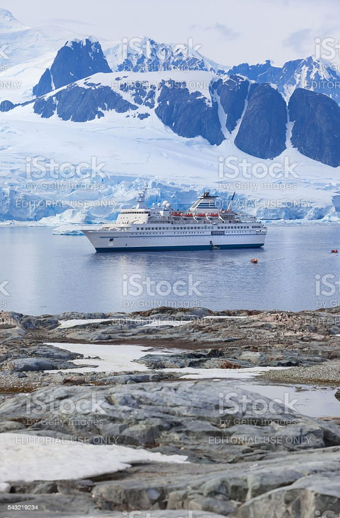 Antartica cruise ship Delphin near Petermanns Island stock photo