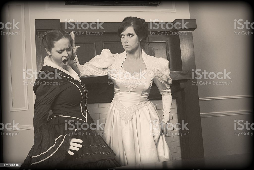 Antebellum Bride Slaps Woman In Black - Vintage royalty-free stock photo