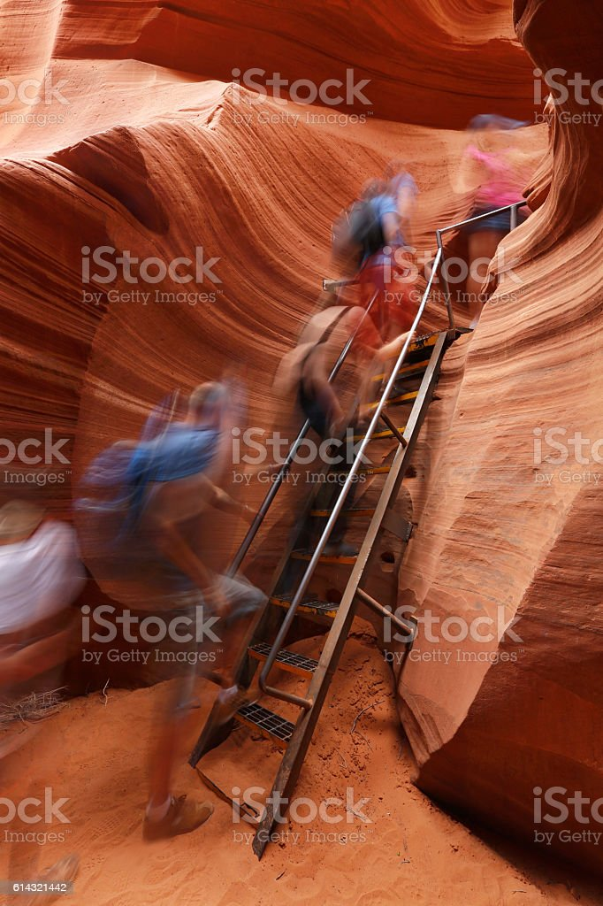 Antelope Canyon with People Climbing Ladder stock photo