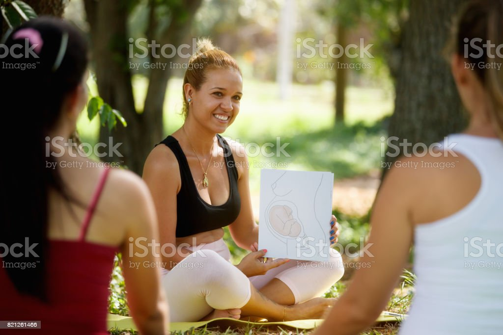 Antenatal Class With Doctor And Pregnant Women In Park stock photo